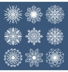 Set of 9 hand drawn symmetric white snowflakes vector