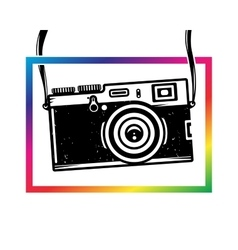 Vintage photo camera out of colorful frame vector image