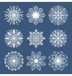 Set of 9 hand drawn symmetric white snowflakes vector