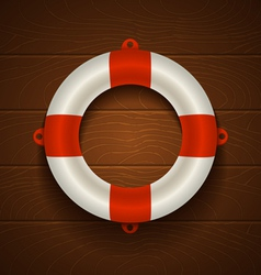 lifebuoy on wooden bacground vector image