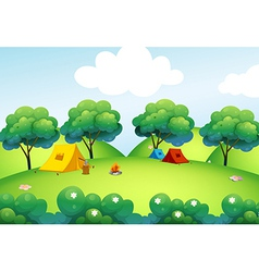Camping tents at the top of the hill vector