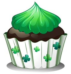 A chocolate cupcake with green toppings vector