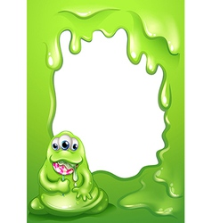 A border template with a fat green monster vector image