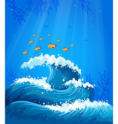 A wave and fishes under the sea vector image