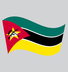 Flag of mozambique waving on gray background vector