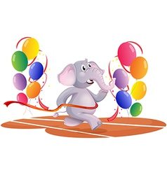 An elephant running with balloons vector