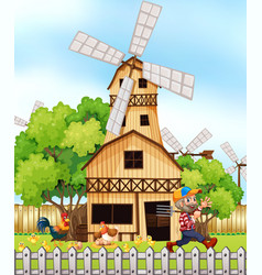 Farmer and chickens by the windmill vector