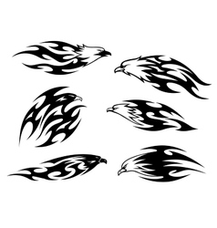 Set of stylized black and white flying eagles vector