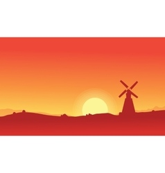 Silhouette of windmill on orange backgrounds vector image vector image