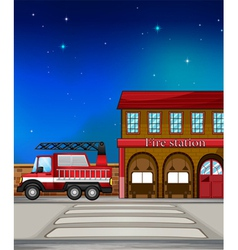 A fire truck near the fire station vector image
