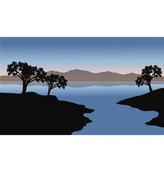 Silhouette of lake and trees vector