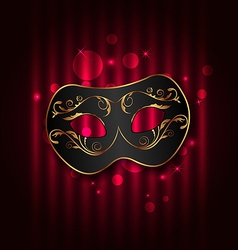 Black carnival ornate mask on glowing background vector