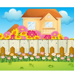A house with blooming flowers vector