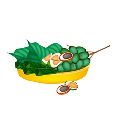 Ripe areca nuts and betel leaves on gold tray vector