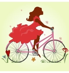A young girl in a red dress rides a bicycle vector