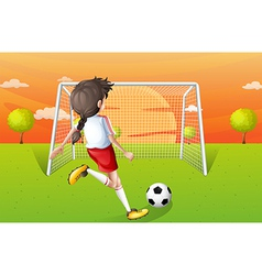A young lady playing football vector image vector image