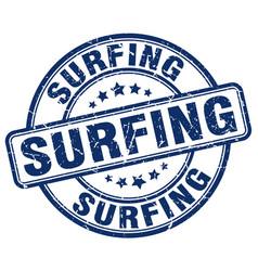 Surfing blue grunge round vintage rubber stamp vector
