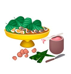 Ripe areca nuts and betel leaves on a tray vector