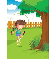 A girl playing with a jumping rope at the garden vector