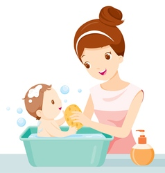Mother washing baby vector