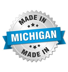 Made in michigan silver badge with blue ribbon vector