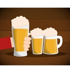 Hand hold beer glass mug witn foam on table vector