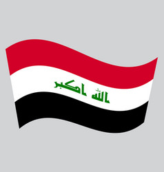 Flag of iraq waving on gray background vector