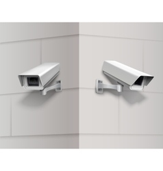 Surveillance cameras on wall vector