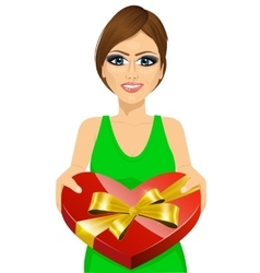 Woman handing over a heart shaped box vector
