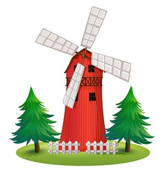A tall wooden building with a windmill vector image