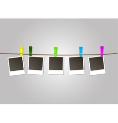 Photo frames on rope with colored clothespins vector