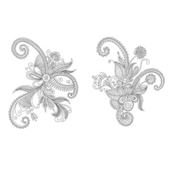 Two intricate swirling floral elements vector