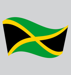 Flag of jamaica waving on gray background vector