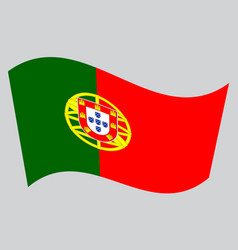 Flag of portugal waving on gray background vector