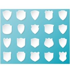 Shiny white shields on blue background vector