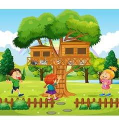 Three kids playing at the treehouse vector image vector image