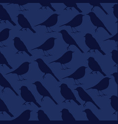 Seamless texture with silhouettes of birds vector