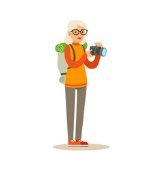 active tourist senior woman with backpack taking vector image