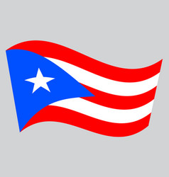 Flag of puerto rico waving on gray background vector