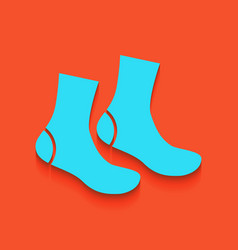 Socks sign whitish icon on brick wall as vector