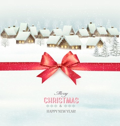 Holiday Christmas background with a village and a vector image