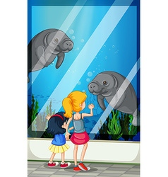 Children looking visiting aquarium vector