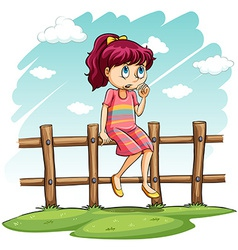 A girl sitting on the fence vector image