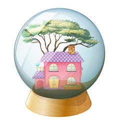 A crystal ball with a beautiful house inside vector