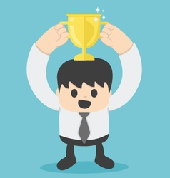Successful businessman with gold cup vector