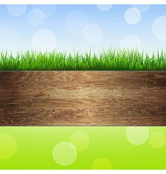 Wooden background with grass vector