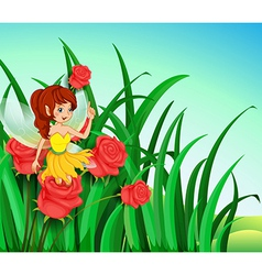 A fairy with a yellow dress at the garden vector