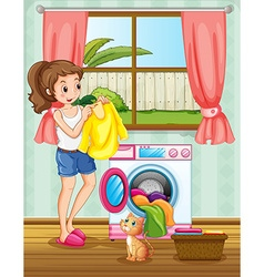 Woman doing laundry in the house vector