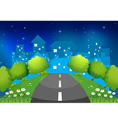 A road at the hill with flowers and trees vector