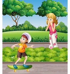 Boy on skateboard and mother in the park vector image vector image
